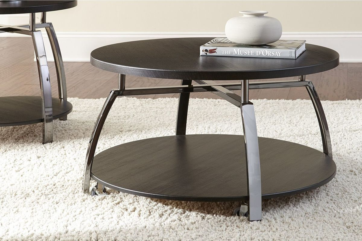 Coham Round Castered Cocktail Table from Gardner-White Furniture