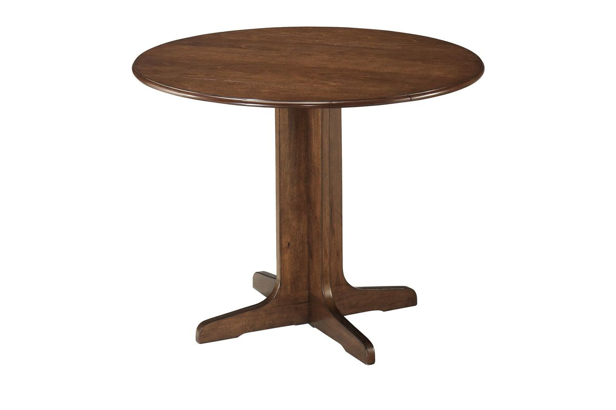 Stuman Round Drop Leaf Table by Ashley from Gardner-White Furniture